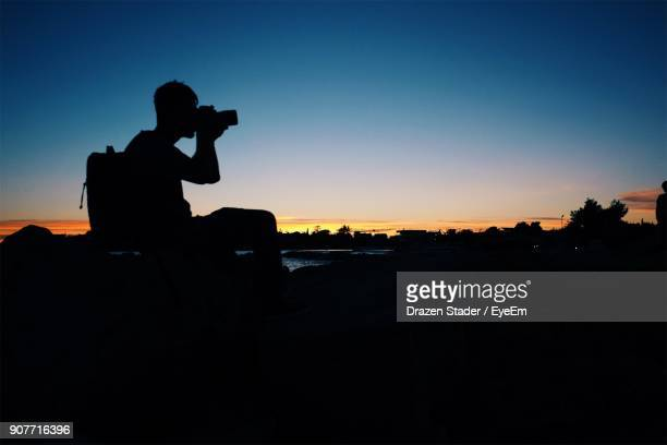 silhouette man photographing during sunset - drazen stock pictures, royalty-free photos & images