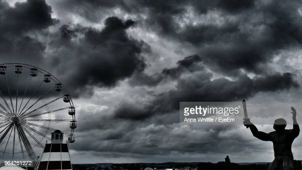 Silhouette Man Standing Against Cloudy Sky