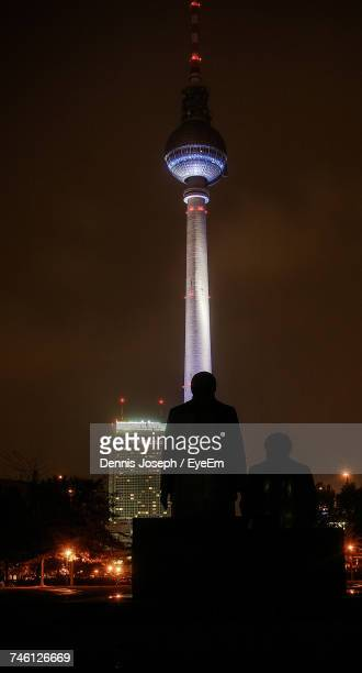 Silhouette Man Standing Against Fernsehturm At Night