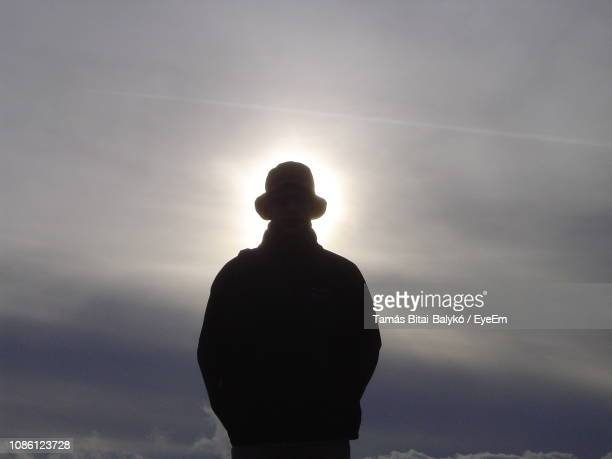 silhouette man standing against sky during sunset - only mid adult men stock pictures, royalty-free photos & images