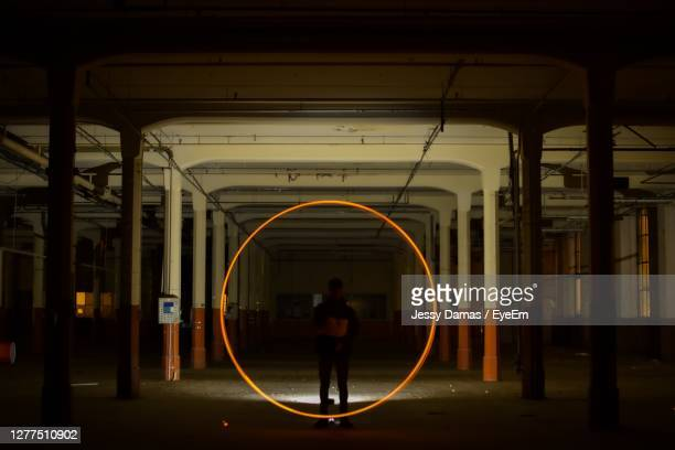 silhouette man standing by circle shape on railroad station - mulhouse stock pictures, royalty-free photos & images