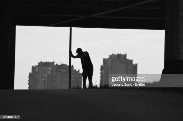 Silhouette Man Standing In City Against Clear Sky