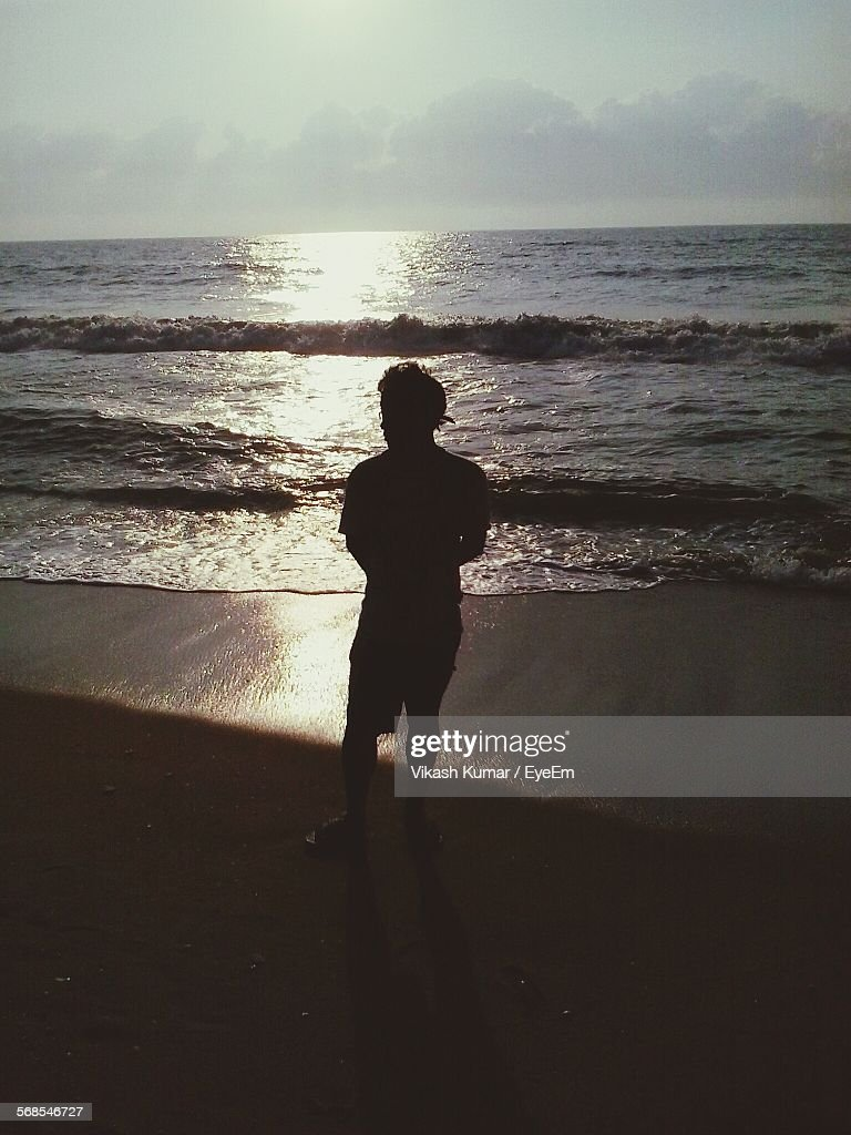 Silhouette Man Standing On Shore Against Sky : Stock Photo