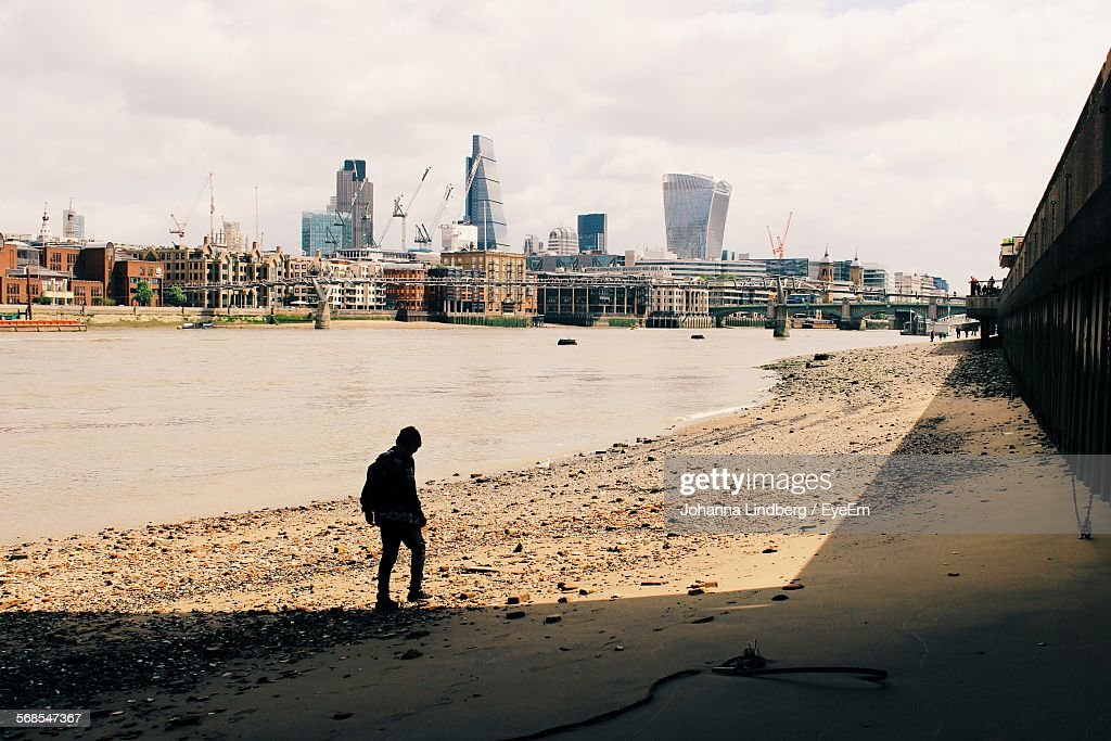 Silhouette Man Standing On Thames Riverbank Against City : Stock Photo