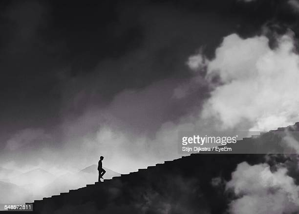 Silhouette Man Walking On Steps Against Sky