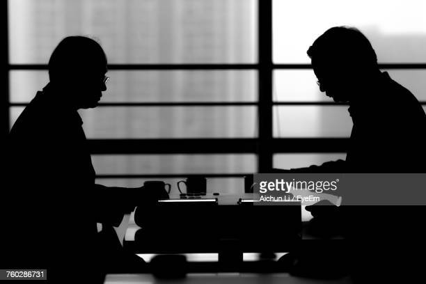 Silhouette Men Playing Go
