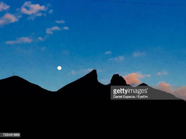 Silhouette Mountain Against Blue Sky