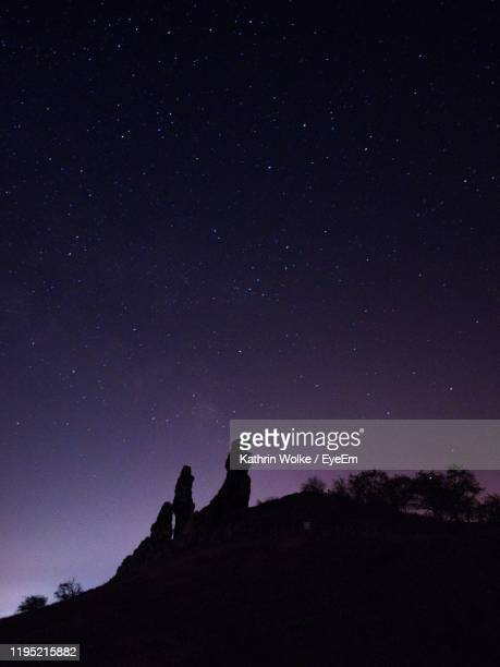 silhouette mountain against sky at night - wolke stock pictures, royalty-free photos & images