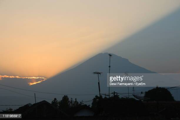 silhouette mountain against sky during sunset - dewi fatmayanti stock photos and pictures