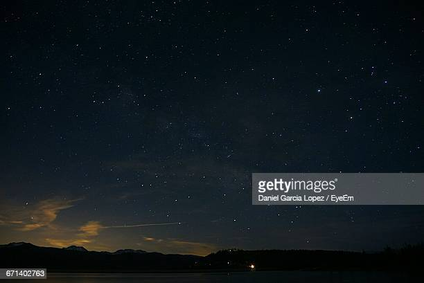 Silhouette Mountains Against Starry Sky At Night