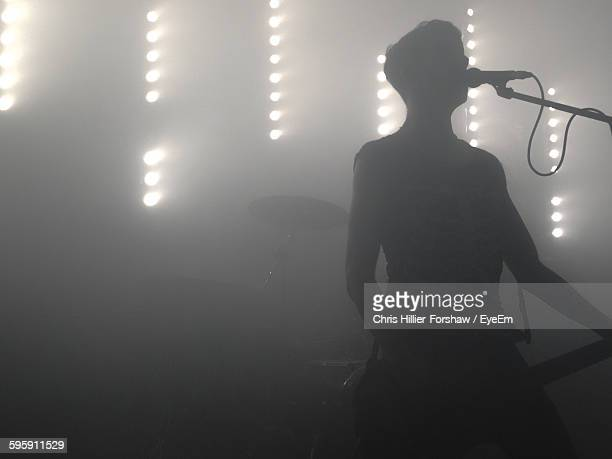 Silhouette Musician Performing On Stage At Nightclub