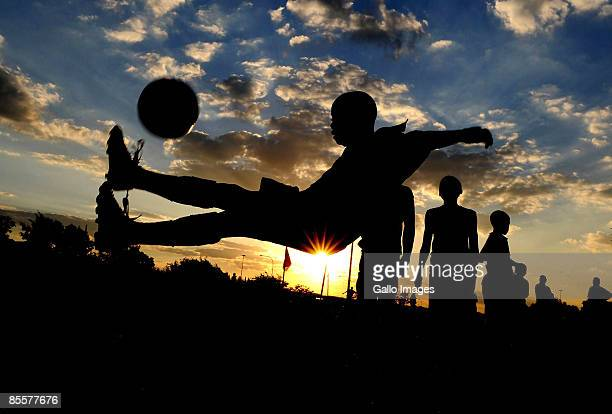 A silhouette of a boy controlling the ball during the Gauteng Future Champions U17 Soccer Tournament on March 24 2009 held in Soweto South Africa