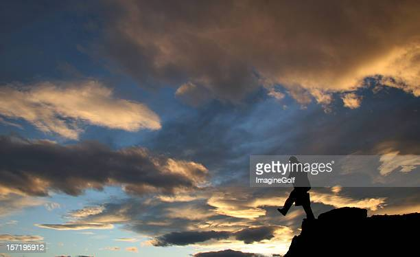 Silhouette of a Businessman Walking Off Cliff
