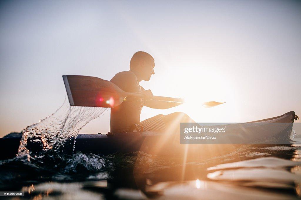 Silhouette of a canoeist : Foto de stock