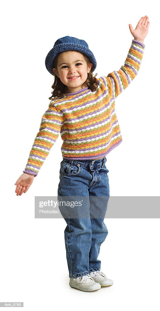 silhouette of a caucasian female child with a cute hat as she playfully waves to the camera : Stockfoto