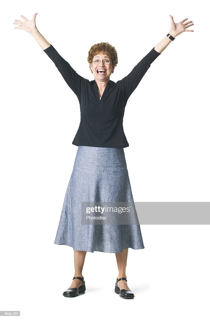 Silhouette of a caucasian woman excitedly  standing with her arms raised. : Foto de stock