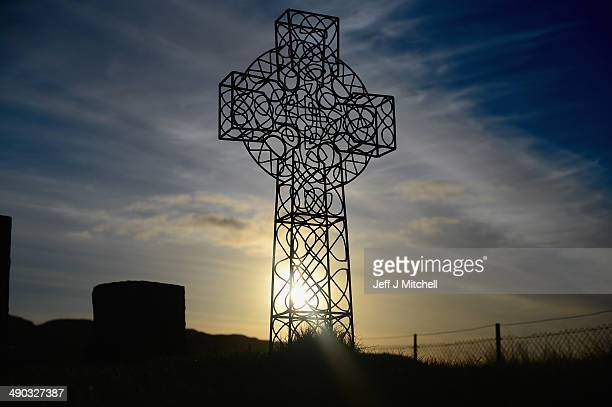 A silhouette of a Celtic cross in Dail Mor cemetery on May 12 2014 in Lewis Scotland A recent study has shown that tourism to Harris and Lewis has...