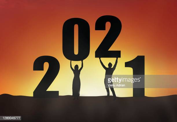 2021 silhouette of a couple standing in the sunset, couple empowerment , new year holiday greeting card - 2010 stock pictures, royalty-free photos & images
