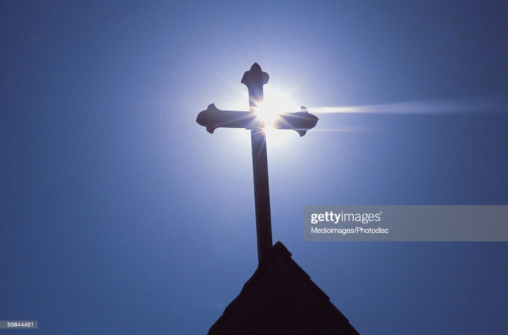 Silhouette of a cross on the roof of a church, Greece : Stock Photo