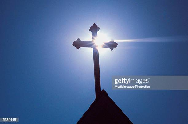 silhouette of a cross on the roof of a church, greece - christianity stock pictures, royalty-free photos & images