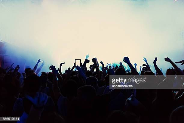 Silhouette of a crowd at a concert