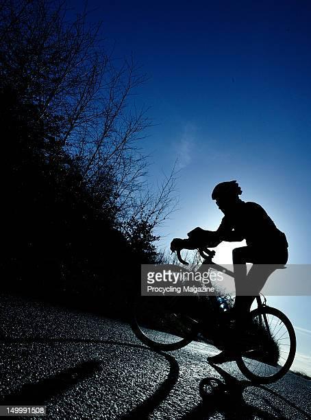 Silhouette of a cyclist on a bike, November 30, 2011.