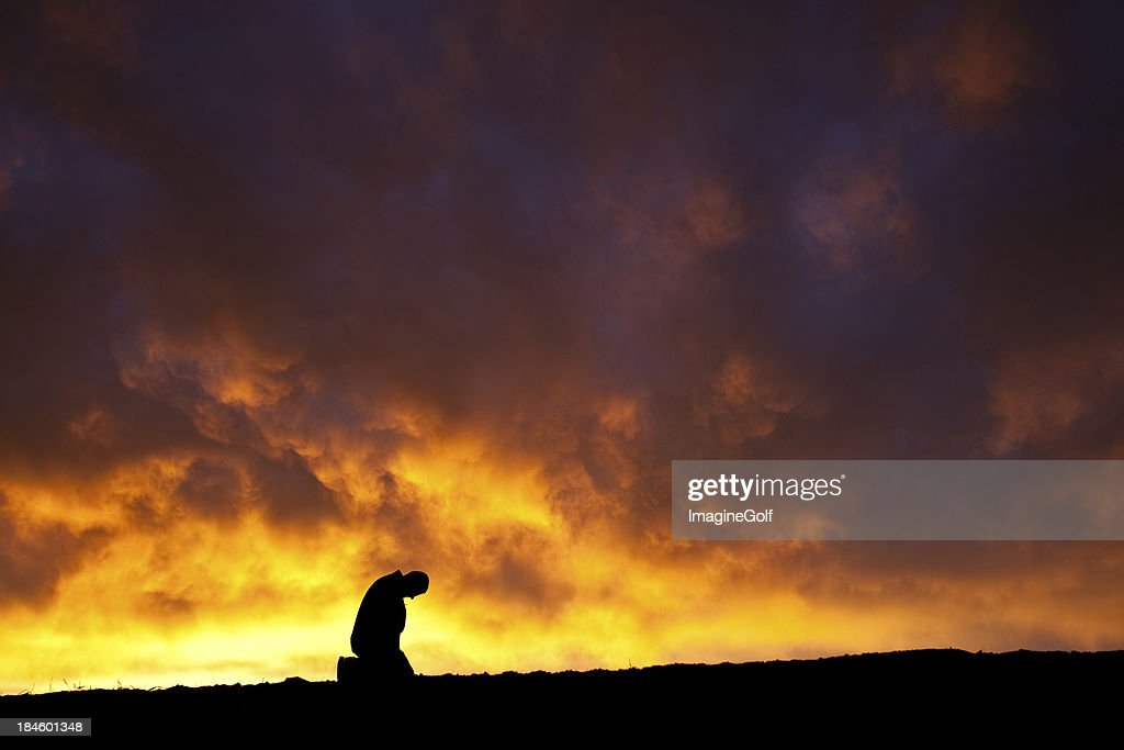 A silhouette of a depressed man : Stock Photo