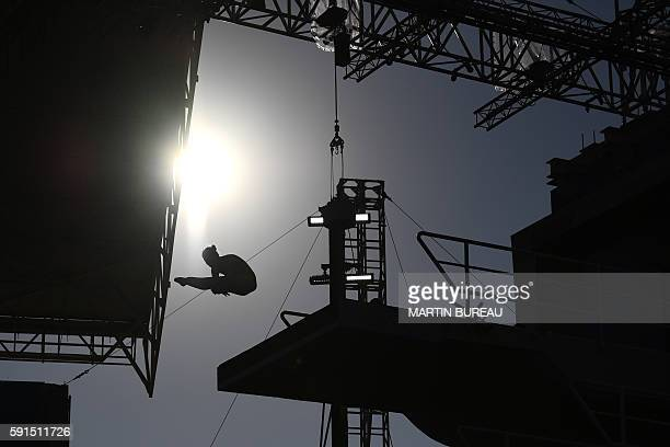 TOPSHOT Silhouette of a diver during the Women's 10m Platform Preliminary at the diving event at the Rio 2016 Olympic Games at the Maria Lenk...