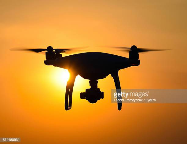 Silhouette Of A Drone At Sunset