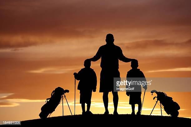 Silhouette of a Family on the Golf Course