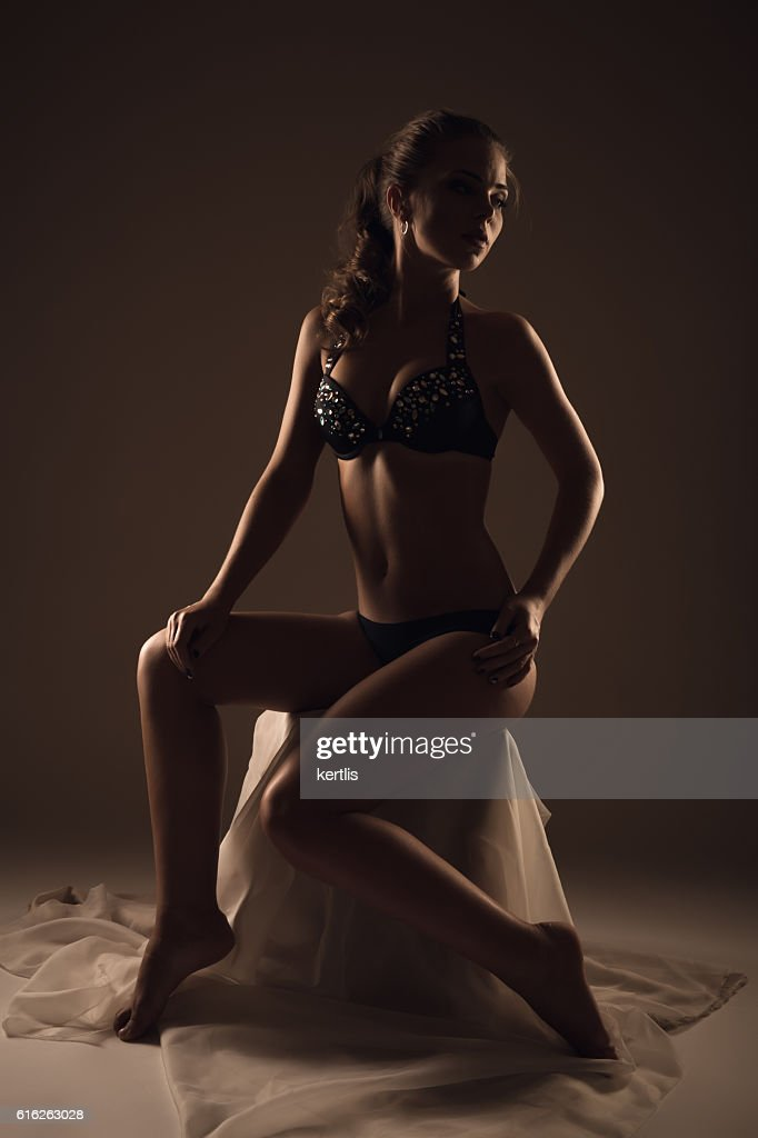 silhouette of a girl in a swimsuit : Stock Photo
