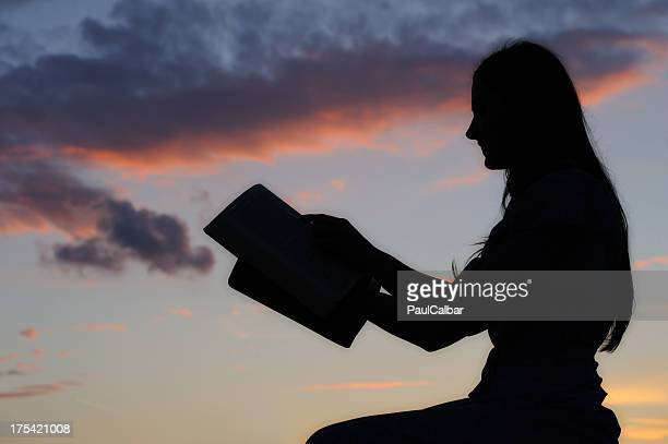 silhouette of a girl - free bible image stock pictures, royalty-free photos & images