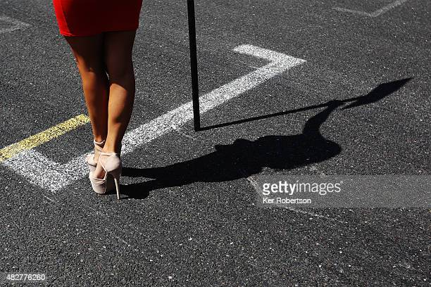Silhouette of a grid girl is seen before the British GT Championship race at Brands Hatch on August 2 2015 in Longfield England