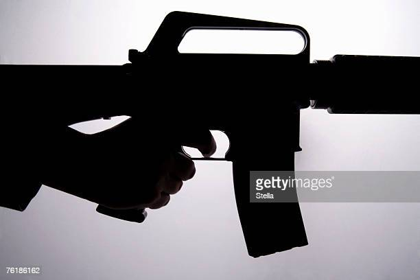 Silhouette of a hand holding a gun