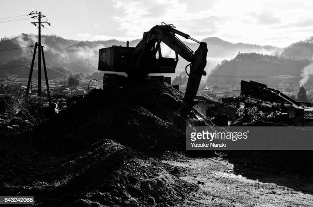 Silhouette of a heavy equipment at a construction site