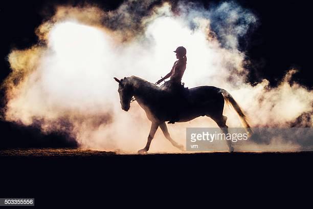 Silhouette of a horseback rider in smoke