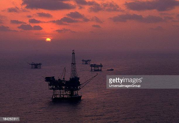 Silhouette of a jack up rig on the ocean