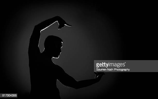 Silhouette of a Male Indian Dancer