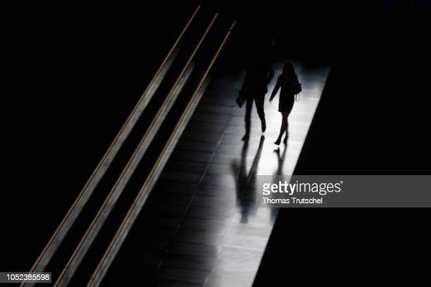Silhouette of a man and a woman on October 17, 2018 in Berlin, Germany.