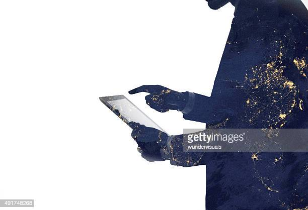 silhouette of a man and digital tablet with galaxy overlaid - touchpad stock pictures, royalty-free photos & images