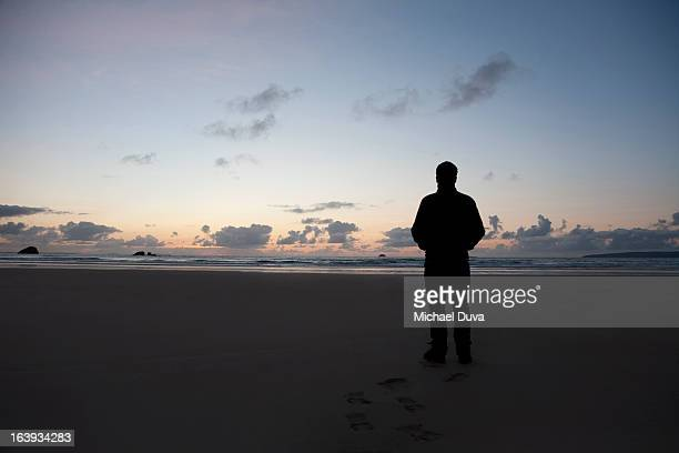 silhouette of a man at sunset on a beach