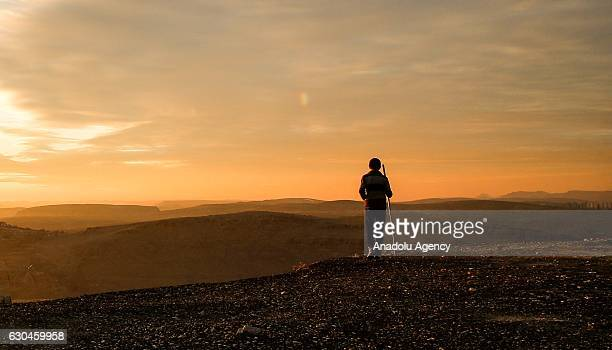 Silhouette of a man is seen at Kasimiye Madrasah's courtyard during a sunset in Mardin Turkey on December 23 2016 Mardin hosts people from different...