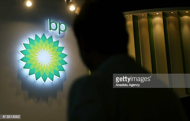 A silhouette of a man is seen in front of 'British Petroleum' logo during the 22nd World Petroleum Congress at Lutfi Kirdar International Convention...