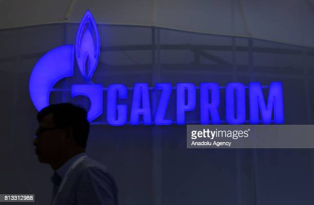 A silhouette of a man is seen in front of 'GAZPROM' logo during the 22nd World Petroleum Congress at Lutfi Kirdar International Convention and...