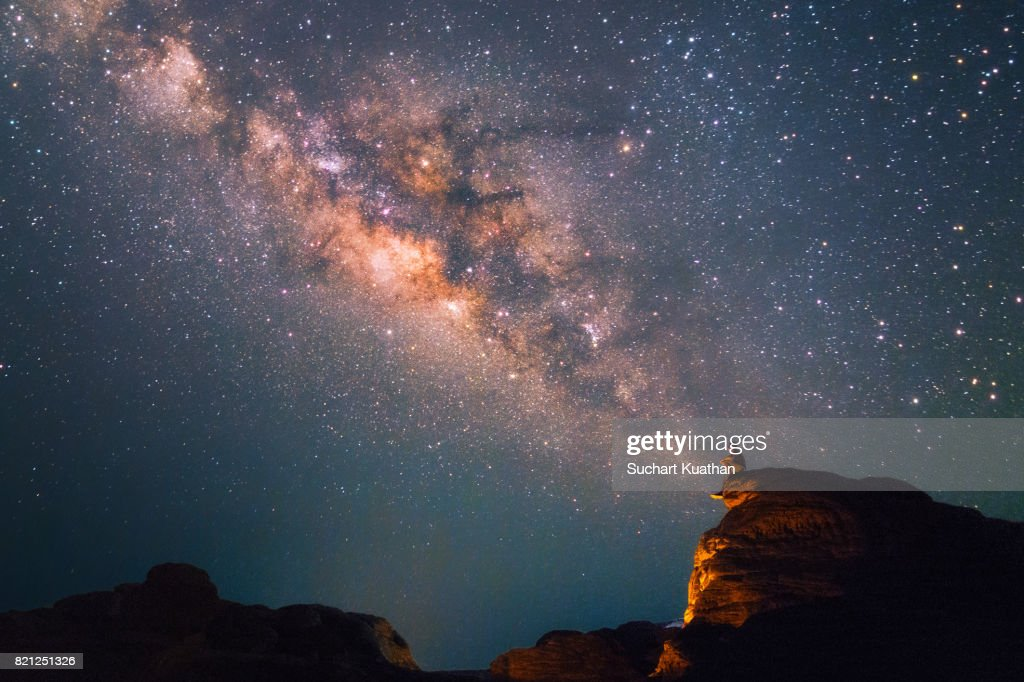 Silhouette of a man looking at the Milky Way Stars shining above the Grand Canyon of Thailand (Sam Phan Bok) : Stock Photo