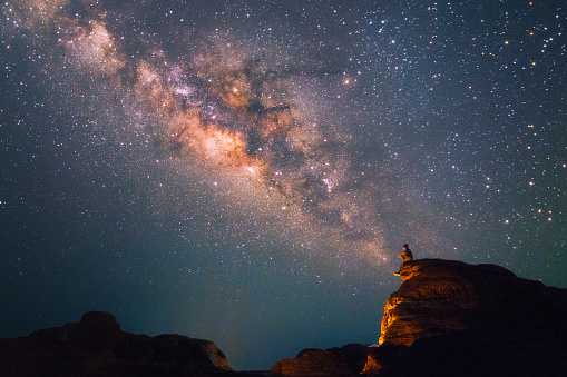 Silhouette of a man looking at the Milky Way Stars shining above the Grand Canyon of Thailand (Sam Phan Bok) - gettyimageskorea