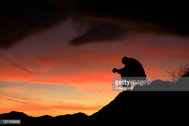 silhouette of a man meditating - struggle stock pictures, royalty-free photos & images