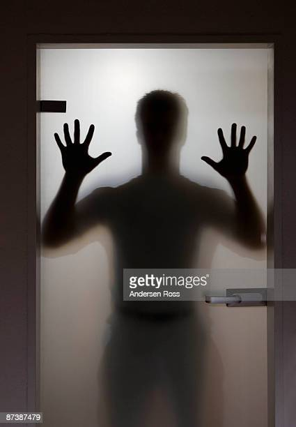 Silhouette of a man on a door