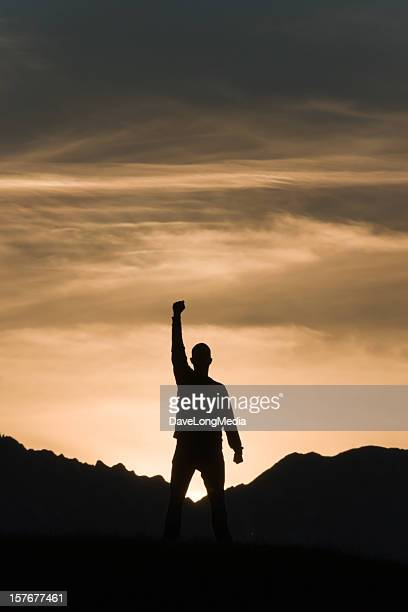 Silhouette of a man on the mountain