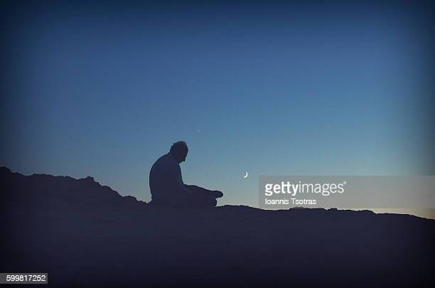 Silhouette of a man on the top of a Rock